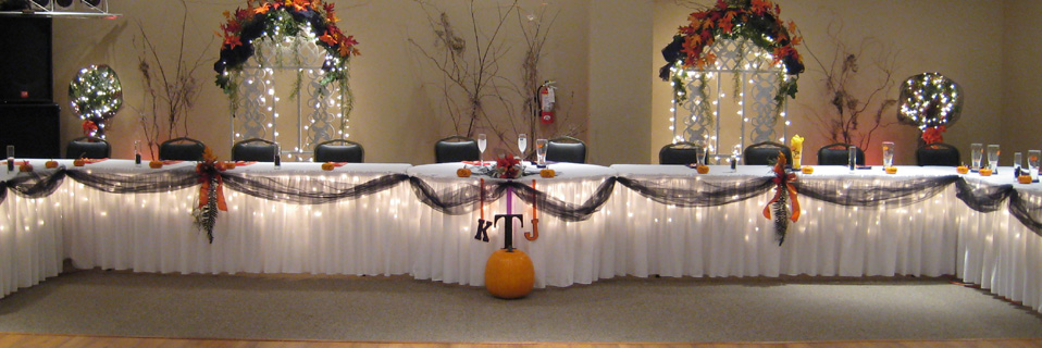The banquet hall will handle setting up the tables for the event.